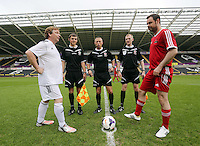 Pictured: Referees with team captains before kick off Danny Dyer (R) and Adam Woodyatt (L). Sunday, 01 June 2014<br /> Re: Celebrities v Celebrities football game organised by Sellebrity Scoccer, in aid of Swansea City Community Trust, at the Liberty Stadium, south Wales.