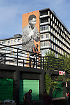 MABONENG, SOUTH AFRICA - MARCH 20: A giant mural of Nelson Mandela as a young boxer on a building in Maboneng district on March 20, 2016 in downtown Johannesburg, South Africa.  A former derelict industrial area, and a no-go area after dark, it is now a vibrant area with artists, businesses, galleries and tourists. A racially mixed cultural hub with markets on the weekend. Maboneng is the idea of young entrepreneur Jonathan Liebmann, and he owns and controls most of the buildings in the area. (Photo by Per-Anders Pettersson/Getty Images)
