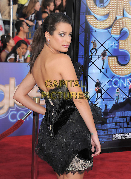 Lea Michele.attends The 20th Century Fox 'Glee 3D' Concert World Movie Premiere held at The Regency Village theatre in Westwood, California, USA, .August 6th 2011..half length ponytail  dress strapless black make-up beauty hair up  eyelashes tulle  silver earrings lace tiered ruffles side back rear behind over shoulder profile hair up ponytail hand on hip .CAP/RKE/DVS.©DVS/RockinExposures/Capital Pictures.