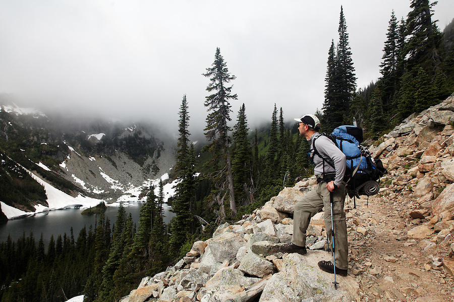 Backpacker on trail to Maple Pass, North Cascades, Washington, USA