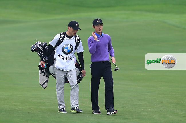 Ouyang Zheng (CHN) on the 14th fairway during Round 2 of the BMW Masters at Lake Malaren Golf Club in Boshan, Shanghai, China on Friday 13/11/15.<br /> Picture: Thos Caffrey | Golffile<br /> <br /> All photo usage must carry mandatory copyright credit (&copy; Golffile | Thos Caffrey)