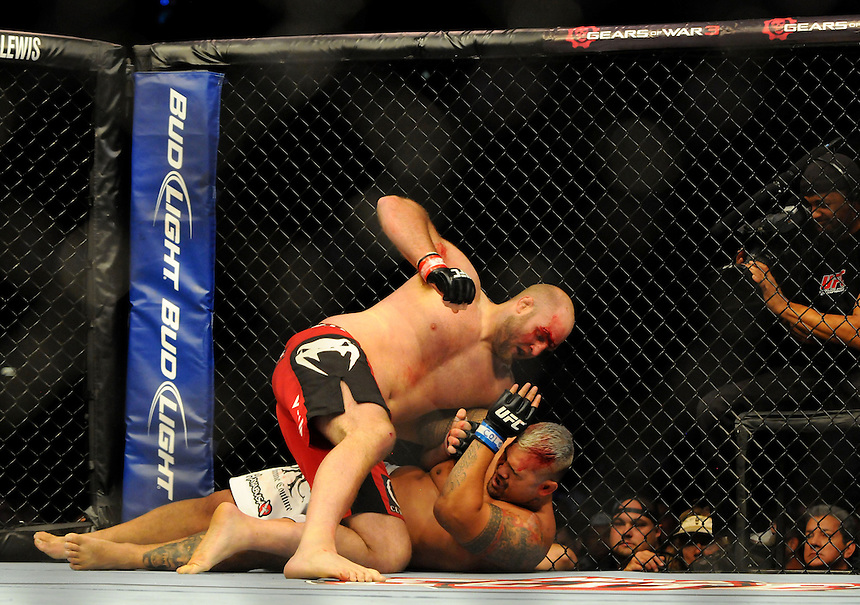 24 SEPTEMBER 2011:    Ben Rothwell in the octagon with Mark Hunt during UFC 135 at the Pepsi Center in Denver, Colorado. *****For Editorial Use Only*****