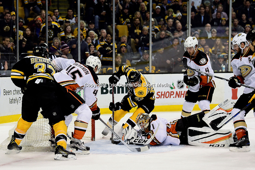 Thursday, December 15, 2016: Anaheim Ducks goalie Jonathan Bernier (1) protects the puck from Boston Bruins left wing Brad Marchand (63) during the National Hockey League game between the Anaheim Ducks and the Boston Bruins held at TD Garden, in Boston, Mass. The Ducks beat the Bruins 4-3 in regulation time. Eric Canha/CSM
