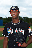 GCL Marlins pitcher Aneury Osoria (10) poses for a photo before the second game of a doubleheader against the GCL Mets on July 24, 2015 at the St. Lucie Sports Complex in St. Lucie, Florida.  GCL Marlins defeated the GCL Mets 5-4.  (Mike Janes/Four Seam Images)