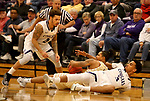 SIOUX FALLS, SD - NOVEMBER 25: Trevon Evans #4 and Jerrod Walton #3 from the University of Sioux Falls battle for the loose ball with KJ Davis #14 from Southwest Minnesota State University during their game Saturday night at the Stewart Center in Sioux Falls. (Photo by Dave Eggen/Inertia)