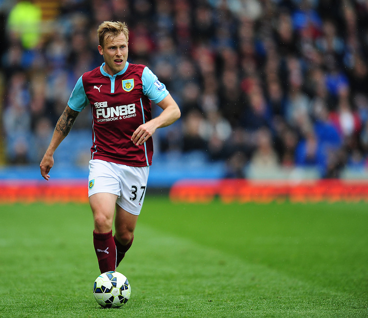 Burnley's Scott Arfield<br /> <br /> Photographer Chris Vaughan/CameraSport<br /> <br /> Football - Barclays Premiership - Burnley v Leicester City - Saturday 25th April 2015 - Turf Moor - Burnley<br /> <br /> &copy; CameraSport - 43 Linden Ave. Countesthorpe. Leicester. England. LE8 5PG - Tel: +44 (0) 116 277 4147 - admin@camerasport.com - www.camerasport.com