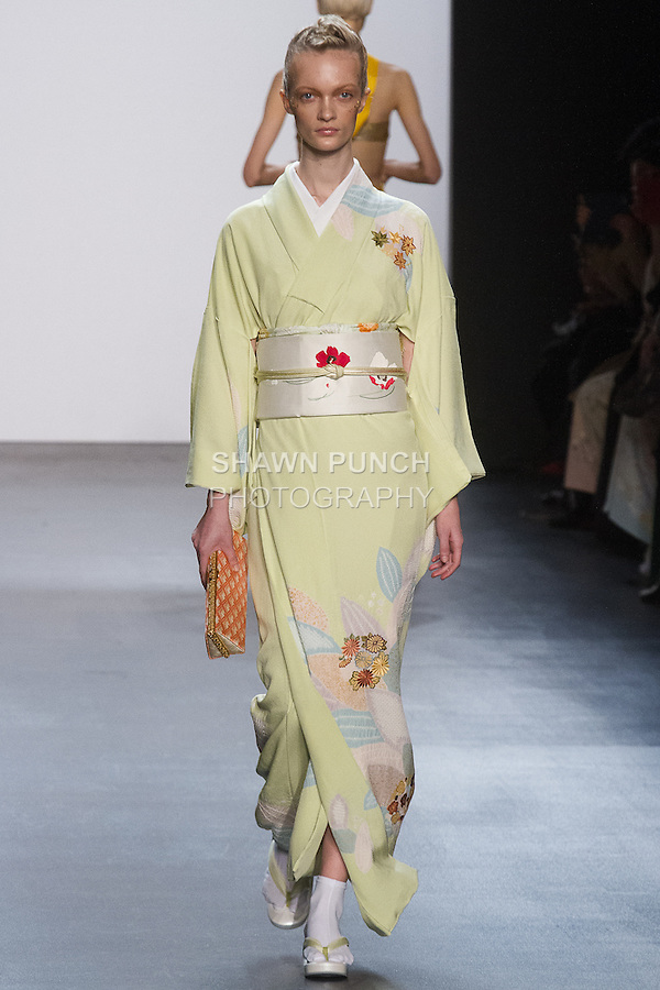 """Model walks runway in a """"Sprouting"""" silk kimono from the Hiromi Asai Fall Winter 2016 """"Spirit of the Earth"""" collection by Hiromi Asai & Kimono Artisan Kyoto, presented at NYFW: The Shows Fall 2016, during New York Fashion Week Fall 2016."""