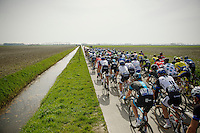 peloton crossing the superflat De Moeren<br /> <br /> Gent-Wevelgem 2014