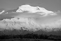 The tallest mountain in the United States, Mount McKinley (20,320') glows softly from the midnight summer sunset.  Denali National Park, Alaska.