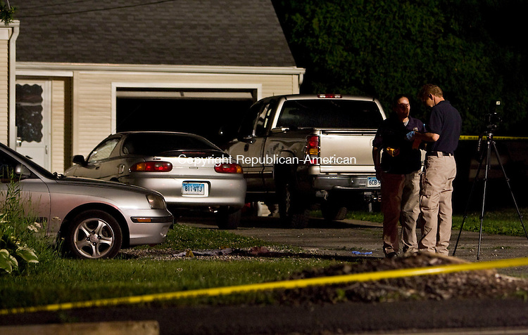 WOLCOTT, CT - 15 JUNE 2010 -061510JT10-<br /> Investigators respond to the scene of a shooting on Tuesday evening at a house on Wolcott Street between Witham and Winterbrook Roads.<br /> Josalee Thrift Republican-American