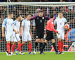 England's players look on in disbelief after referee Antonio Miguel Mateu awards the Netherland's second goal during the International friendly match at Wembley.  Photo credit should read: David Klein/Sportimage