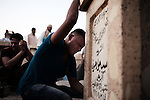 NAJAF, Iraq: 16th June 2014<br /> <br /> Funeral for Mehdi Abdullah Jama, a 22 year-old volunteer soldier killed in Samarra. Jama was buried by his mother, father and five brothers in Najaf's Shiite-venerated cemetery Wadi al Salaam, the largest graveyard on earth.<br /> <br /> &ldquo;He volunteered to protect the shrine here why did they send him to Samarra?&rdquo; one mourner yelled. &ldquo;Why, why send him to a front!&rdquo; <br /> <br /> Fixer: Haider Kata +9647704425647<br /> <br /> Ayman Oghanna for National Geographic