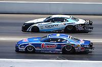 Jun 18, 2017; Bristol, TN, USA; NHRA pro stock driver Jason Line (near) alongside Shane Gray during the Thunder Valley Nationals at Bristol Dragway. Mandatory Credit: Mark J. Rebilas-USA TODAY Sports