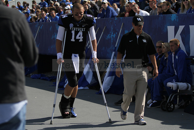 UK freshman quarterback Patrick Towles walks to the bench in the second half of the University of Kentucky football game vs. the Mississippi State Bulldogs at Commonwealth Stadium in Lexington, Ky., on Oct. 6, 2012. Mississippi State won 27-14. Towles was injured in the first half. Photo by Becca Clemons | Staff