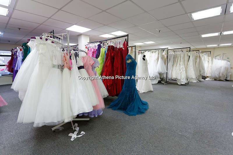"""COPY BY TOM BEDFORD<br /> Pictured: Some of the wedding dresses on display at the John Pye Auctions warehouse in Pyle, south Wales, UK.<br /> Re: A bride cried tears of joy after her missing wedding dress was found among a pile of 20,000 gowns in a warehouse.<br /> Meg Stamp, 27, paid £1,300 for the beautiful ivory lace dress but it  was seized by liquidators after a bridal company went bust.<br /> It was boxed up along with 20,000 others and due to be sold for a knock-down price at auction.<br /> But determined Meg banged on the auctioneer door saying: """"I want my dress back"""".<br /> Staff at John Pye auctioneers in Port Talbot spent three hours sifting through boxes until they finally found Meg's dream dress.COPY BY TOM BEDFORD<br /> Pictured: at the John Pye Auctions warehouse in Pyle, south Wales, UK.<br /> Re: A bride cried tears of joy after her missing wedding dress was found among a pile of 20,000 gowns in a warehouse.<br /> Meg Stamp, 27, paid £1,300 for the beautiful ivory lace dress but it  was seized by liquidators after a bridal company went bust.<br /> It was boxed up along with 20,000 others and due to be sold for a knock-down price at auction.<br /> But determined Meg banged on the auctioneer door saying: """"I want my dress back"""".<br /> Staff at John Pye auctioneers in Port Talbot spent three hours sifting through boxes until they finally found Meg's dream dress."""