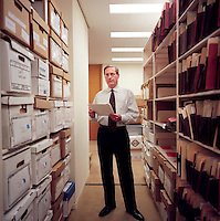 USA. Houston. 12 November 2007..Michael Goldberg, a lawyer with Baker Botts in Houston who has taken on Linda Carty's case. Photographed next to all the case files for Linda, this is in stark contrast to her defence layer, Jerry Guerinot, who only spent one hour with her before the beginning of the trial..©Andrew Testa