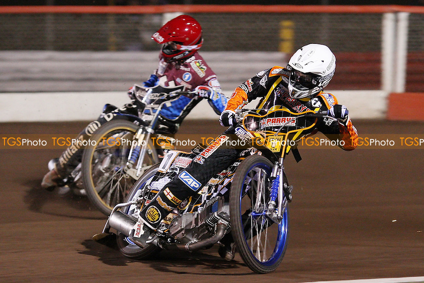 Heat 13: Fredrik Lindgren (white) and Krzysztof Kasprzak (red) - Lakeside Hammers vs Wolverhampton Wolves, Elite Shield Speedway at the Arena Essex Raceway, Purfleet - 26/03/10 - MANDATORY CREDIT: Rob Newell/TGSPHOTO - Self billing applies where appropriate - 0845 094 6026 - contact@tgsphoto.co.uk - NO UNPAID USE.