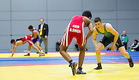 11 MAY 2014 - SHEFFIELD, GBR - Ryan Kay (right) and Bobby Singh look for an opening in each others defence at the British 2014 Senior Wrestling Championships in EIS in Sheffield, Great Britain (PHOTO COPYRIGHT © 2014 NIGEL FARROW, ALL RIGHTS RESERVED)