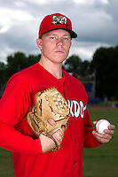 Batavia Muckdogs pitcher Jon Cornelius #26 poses for a photo before the first day of practice for the start of the NY-Penn League at the Dwyer Stadium in Batavia, New York;  June 13, 2011.  (Mike Janes/Four Seam Images)