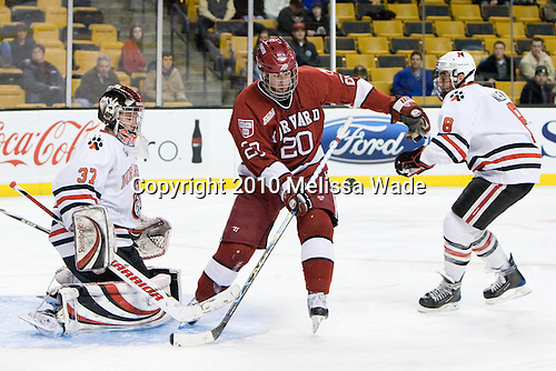 Chris Rawlings (NU - 37), Louis Leblanc (Harvard - 20), J.P. Maley (NU - 8) - The Northeastern University Huskies defeated the Harvard University Crimson 4-1 (EN) on Monday, February 8, 2010, at the TD Garden in Boston, Massachusetts, in the 2010 Beanpot consolation game.