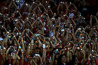 Fans in the north-end student section use their phone flashlights during the O-H-I-O cheer during the fourth quarter of the NCAA football game between the Ohio State Buckeyes and the Northwestern Wildcats at Ohio Stadium on Saturday, October 29, 2016. (Columbus Dispatch photo by Jonathan Quilter)