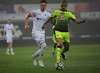 Pictured: (L-R) Joe Rodon of Swansea City against Tennai Watson of Reading Monday 15 May 2017<br />