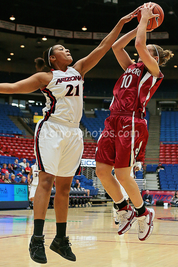 Jan 17, 2008; Tucson, AZ, USA; Arizona Wildcats forward Rheya Neabors blocks a shot by Stanford Cardinal guard Arizona Wildcats guard J.J. Hones during a game at the McKale Center.  The Cardinal won the game 89-64.