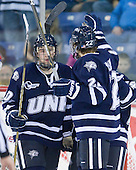 Dalton Speelman (UNH - 10), Stevie Moses (UNH - 22) celebrate Moses' goal. - The visiting University of New Hampshire Wildcats defeated the University of Massachusetts-Lowell River Hawks 3-0 on Thursday, December 2, 2010, at Tsongas Arena in Lowell, Massachusetts.