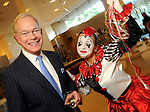 Jay Jones is entertained by mime Amber Juday at the Legacy Community Health Services 11th spring soir?e at Neiman Marcus Sunday May 02,2010.  (Dave Rossman Photo)