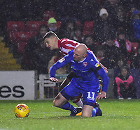 Lincoln City's Harry Anderson vies for possession with Morecambe's Kevin Ellison<br /> <br /> Photographer Andrew Vaughan/CameraSport<br /> <br /> The EFL Sky Bet League Two - Saturday 15th December 2018 - Lincoln City v Morecambe - Sincil Bank - Lincoln<br /> <br /> World Copyright © 2018 CameraSport. All rights reserved. 43 Linden Ave. Countesthorpe. Leicester. England. LE8 5PG - Tel: +44 (0) 116 277 4147 - admin@camerasport.com - www.camerasport.com