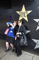 Mourning Prince's death by taking selfie in front of his star at First Avenue Nightclub. Minneapolis Minnesota MN USA
