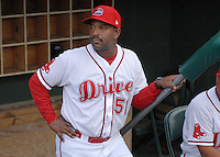 Manager Billy McMillon (51) of the Greenville Drive, Class A affiliate of the Boston Red Sox, waits in the dugout before a game against the Augusta GreenJackets on April 7, 2011, at Fluor Field at the West End in Greenville, S.C. Photo by Tom Priddy / Four Seam Images