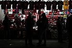 Fans inspect items at a merchandise stand outside the ground before the Coppa Italia match at Giuseppe Meazza, Milan. Picture date: 13th February 2020. Picture credit should read: Jonathan Moscrop/Sportimage