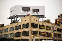 Advertising for the Apple iPad Mini and the full-size iPad on a billboard atop the Apple store in the the trendy Meatpacking District in New York on Thursday, February 7, 2013.  (© Richard B. Levine)
