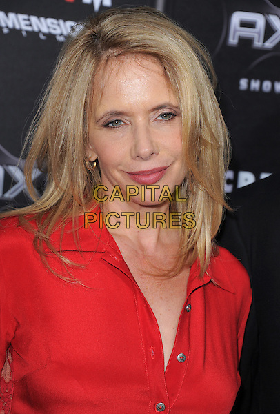 ROSANNA ARQUETTE .at the Weinstein World Premiere of 'Scream 4' held at The Grauman's Chinese Theatre in Hollywood, California, USa, April 11th 2011..portrait headshot red shirt .CAP/RKE/DVS.©DVS/RockinExposures/Capital Pictures.