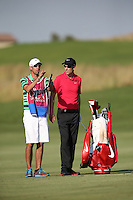 Ross Fisher (ENG) and caddie prepare their second shot to the last during Round Two of The Tshwane Open 2014 at the Els (Copperleaf) Golf Club, City of Tshwane, Pretoria, South Africa. Picture:  David Lloyd / www.golffile.ie