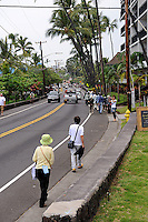 A group of Japanese tourists walking along the roadside into Kailua-Kona. Big Island, Hawaii RIGHTS MANAGED LICENSE AVAILABLE FROM www.PhotoLibrary.com