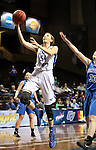 SIOUX FALLS MARCH 23:  Tess Bruffey #54 from Lubbock Christian takes the ball to the basket past Jen Gemma #33 from Bentley University during their 2016 NCAA Women's DII Elite 8 Basketball Championship semifinal Wednesday night at the Sanford Pentagon in Sioux Falls, S.D. (Photo by Dave Eggen/Inertia)