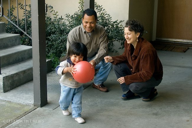 Berkeley CA Adoptive parents playing with Guatemalan daughter, two-years-old  MR