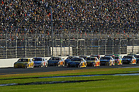 Clint Bowyer (#33) leads the field on the back straight.
