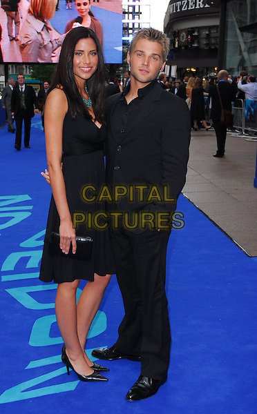 "MIKE VOGEL & GUEST.At the UK Film Premiere of ""Poseidon"", .Empire Leicester Square, London, .May 28th 2006..full length couple.Ref: CAN.www.capitalpictures.com.sales@capitalpictures.com.©Can Nguyen/Capital Pictures"