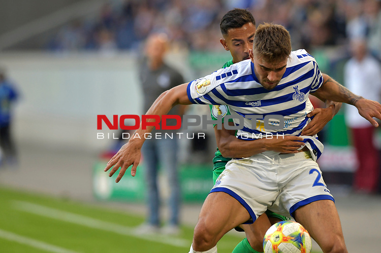 11.08.2019 , Schauinsland-Reisen Arena, Duisburg, DFB Pokal<br /> <br /> DFB REGULATIONS PROHIBIT ANY USE OF PHOTOGRAPHS AS IMAGE SEQUENCES AND/OR QUASI-VIDEO.<br /> <br /> im Bild / picture shows Joshua Bitter ( MSV Duisburg #23 ) gegen K. Redondo ( Greuther Fuerth #27 ).<br /> <br /> <br /> Foto © nordphoto / Freund