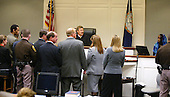 Mildred Muhammad, far right on witness stand, ex wife, of convicted sniper John Allen Muhammad, far left, testifies during a bench conference in the penalty phase of the Muhammad trial in Virginia Beach Circuit Court in Virginia Beach, Virginia on November 19, 2003.   Now in the punishment phase of the trial, the jury can only choose execution or life in prison without parole for Muhammad, who was found guilty Monday, November 17, 2003 of all charges, including two capital murder counts, in one of 10 fatal shootings that terrorized the Washington, D.C., area in 2002. <br /> Credit: Tracy Woodward - Pool via CNP