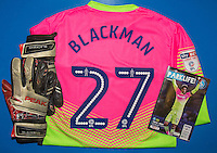 Goalkeeper Jamal Blackman of Wycombe Wanderers shirt, gloves and matchday programme during the Sky Bet League 2 match between Wycombe Wanderers and Yeovil Town at Adams Park, High Wycombe, England on 14 January 2017. Photo by Andy Rowland / PRiME Media Images.