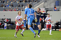New York Red Bulls goalkeeper Frank Rost (1) denies Chad Barrett (11) of the Los Angeles Galaxy. The New York Red Bulls defeated the Los Angeles Galaxy 2-0 during a Major League Soccer (MLS) match at Red Bull Arena in Harrison, NJ, on October 4, 2011.