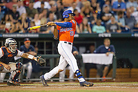 Florida Gators outfielder Buddy Reed (23) follows through on his swing against the Virginia Cavaliers in Game 13 of the NCAA College World Series on June 20, 2015 at TD Ameritrade Park in Omaha, Nebraska. The Cavaliers beat the Gators 5-4. (Andrew Woolley/Four Seam Images)