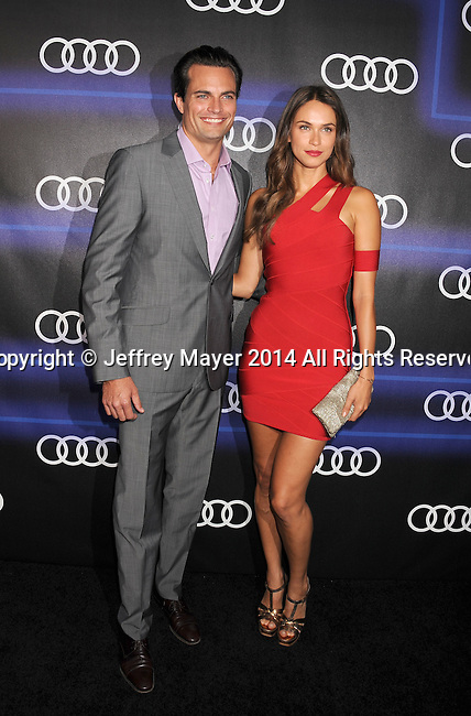 LOS ANGELES, CA- AUGUST 21: TV personality Asha Leo (R) and guest at the Audi Emmy Week Celebration at Cecconi's Restaurant on August 21, 2014 in Los Angeles, California.