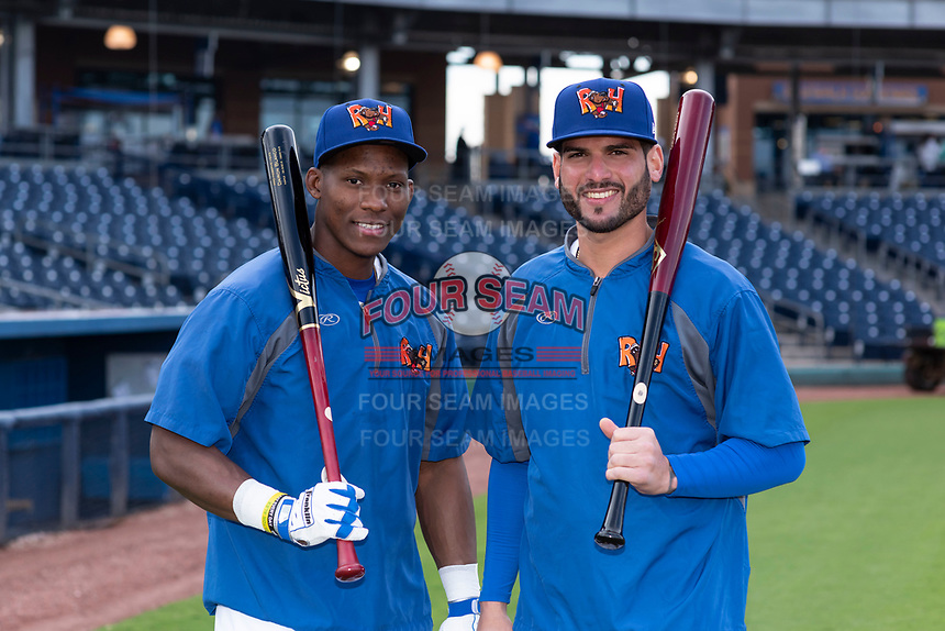 Midland RockHounds outfielders Dairon Blanco (15) and Luis Barrera (22) pose for a photo before a Texas League game against the Tulsa Drillers at Security Bank Ballpark on April 24, 2019 in Midland, Texas. (Zachary Lucy/Four Seam Images)