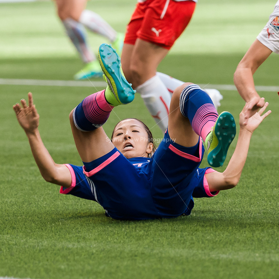 June 8, 2015: Rumi UTSUGI of Japan falls onto her back during a Group C match at the FIFA Women's World Cup Canada 2015 between Japan and Switzerland at BC Place Stadium on 8 June 2015 in Vancouver, Canada. Sydney Low/AsteriskImages