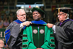 Kingsley Antwi- Boasiako (Center)  receives his Doctor of Philosphy from Dr. Steve Howard (Right) and Dean Brian Scott Titsworth. Photo by Ben Siegel
